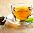 Hot tea with green leaf - Stock Photo