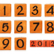 Numbers on wooden painted cubes — Stock Photo