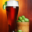 Beer with hop and wheat still-life — Stock Photo