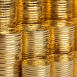 Stock Photo: Shiny new coins stack background