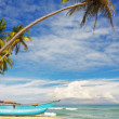 Sri-Lanka sunny coast with fishers boat — Stock Photo