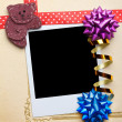 Scrap vintage blank photo frame with ribbons and bow — Stock Photo