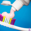 Toothbrush and toothpaste - Stock Photo