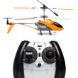 Remote controlled helicopter with controlling handset — Stock Photo #11389084