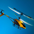 Flying remote controlled helicopter — Stock Photo