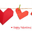 Valentines day card with origami hearts on a rope — Stock Photo #11389125