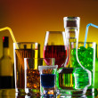 Different alcohol drinks and cocktails on bar — Stock Photo #11389241
