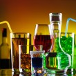 Stock Photo: Different alcohol drinks and cocktails on bar