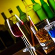 Different alcohol drinks and cocktails on bar — Stock Photo #11389247