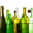 Different alcohol drinks bottles isolated on white — Stock Photo