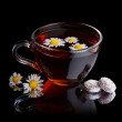 Herbal tea with sweet candys — Stock Photo