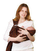 Mother with baby in a sling — Stock Photo