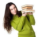 Girl holding books — Стоковое фото