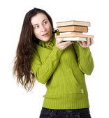 Flicka anläggning böcker — Stockfoto