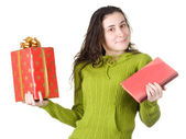 Girl with book and the gift — Stock Photo