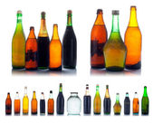 Old multicolored wine bottles with natural dust and dirtiness — Stock Photo
