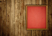 Picture frame on wooden wall — Stock Photo