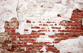 Old weathered brick wall with stucco — Foto Stock