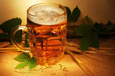 Beer on sacking with wheat and hop still-life — Stock Photo
