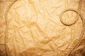 Rope on aged yellow paper — Stock Photo