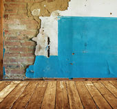Abaddoned room with old painted brick wall — Stock Photo