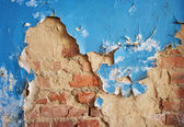 Blue weathered painted wall with cracked paint — Stock Photo
