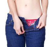 Young woman in unzipped jeans — Stock Photo