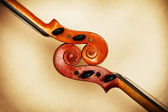 Two old violin scrolls detail in ambient light — Stock Photo