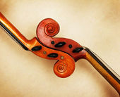 Two old violin scrolls detail in ambient light — Stockfoto