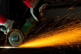 Sparks while grinding iron — Stock Photo