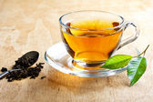 Hot tea with green leaf — Stock Photo