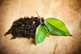 Tea with green leaf — Stock Photo