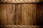 Rope on weathered wood background — Stock Photo