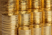 Shiny new coins stack background — Stock Photo