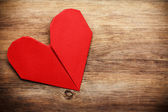 Origami heart on wooden background — Stock Photo