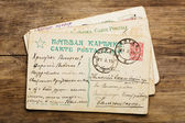 Antique russian post card stack with greetings — Stock Photo