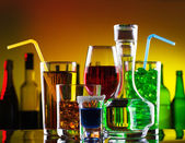 Different alcohol drinks and cocktails on bar — Stock Photo