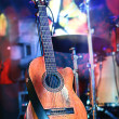 Concert. The guitar on the background of a scene. — Stock Photo