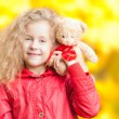 Stock Photo: Beautiful little girl with teddy bear.