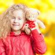 Beautiful little girl with teddy bear. — Stock Photo