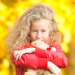 Beautiful little girl with teddy bear — Stock Photo #11431139