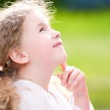 Beautiful little girl smiling and looking up — Stock Photo