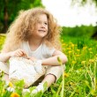 Little girl on flower field — Stock Photo
