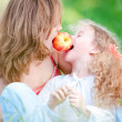 Young mother and her daughter eating — Foto Stock