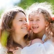 Happy daugher and mother — Stock Photo #11431181