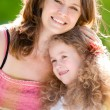 Stock Photo: Young mother hugging her daughter