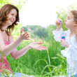 Mother and duaghter playing — Stock Photo