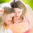 Little girl and her mother with butterfly net — Stock Photo