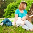 Stock Photo: Mother reading book to her daughter