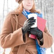 Royalty-Free Stock Photo: Young woman with books in winter